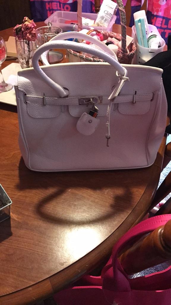 White handbags locks with key