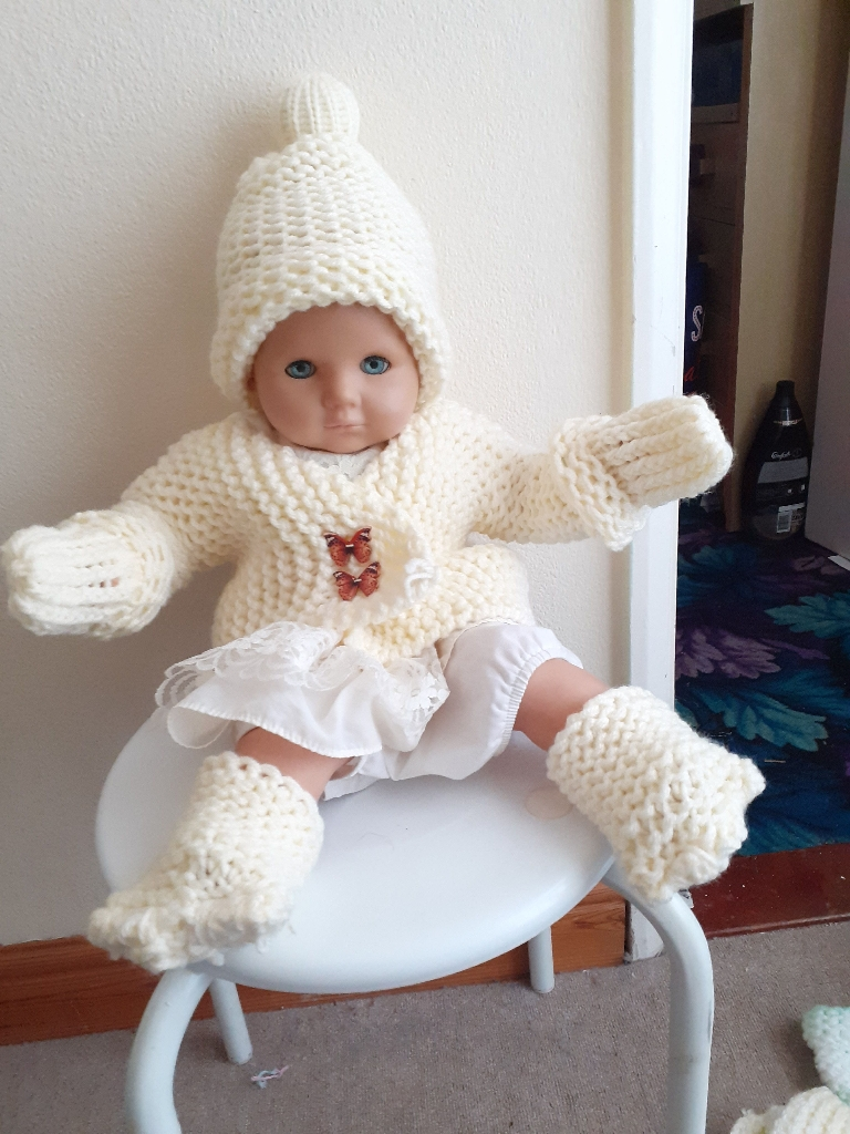 Handmade knitted sets for real babies and reborn dolls each