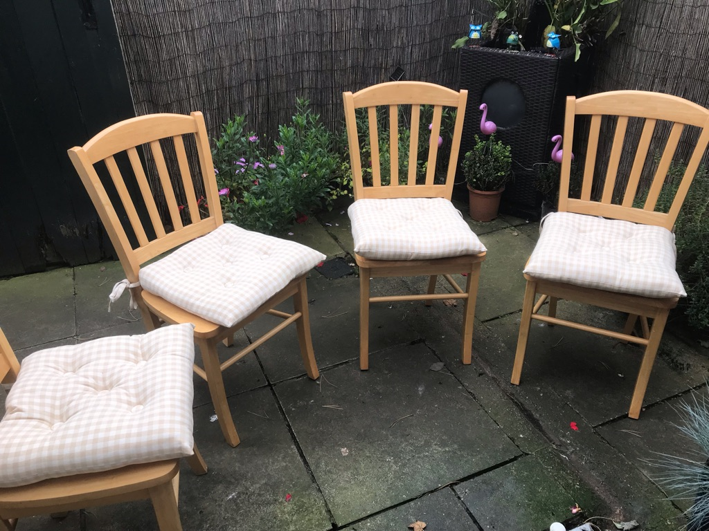 Four dining chairs with chair cushions