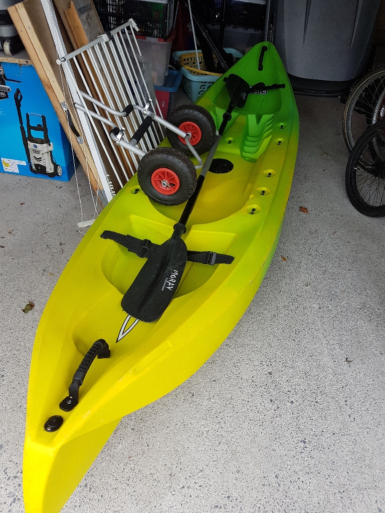 Sit on top kayak plus 2 helly hansen life jackets , wheels and more