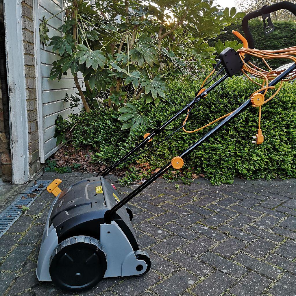 Lawn aerator and rake