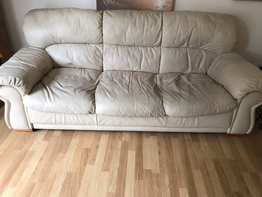 2 and 3 seater cream leather sofa with foot stool