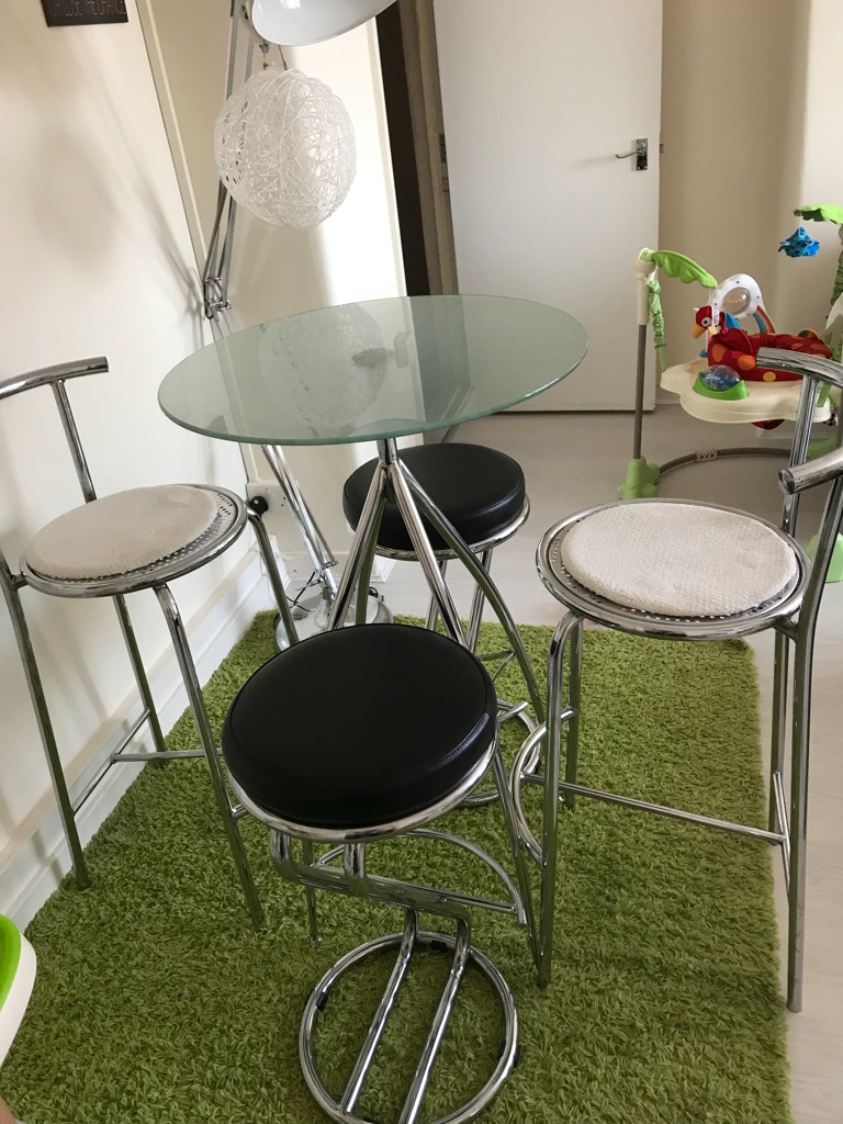 High glass table and 4 chairs