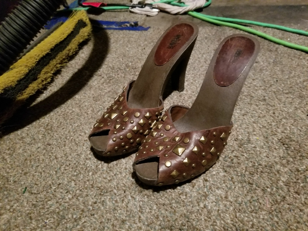 Cute brown wooden heels .