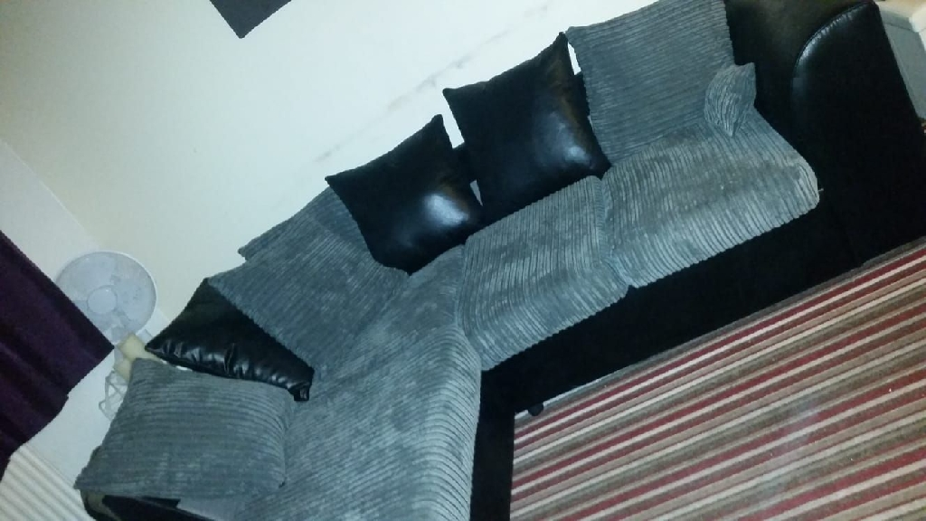 Immaculate gray jumbo cord n black leather at bottom left corner sofa