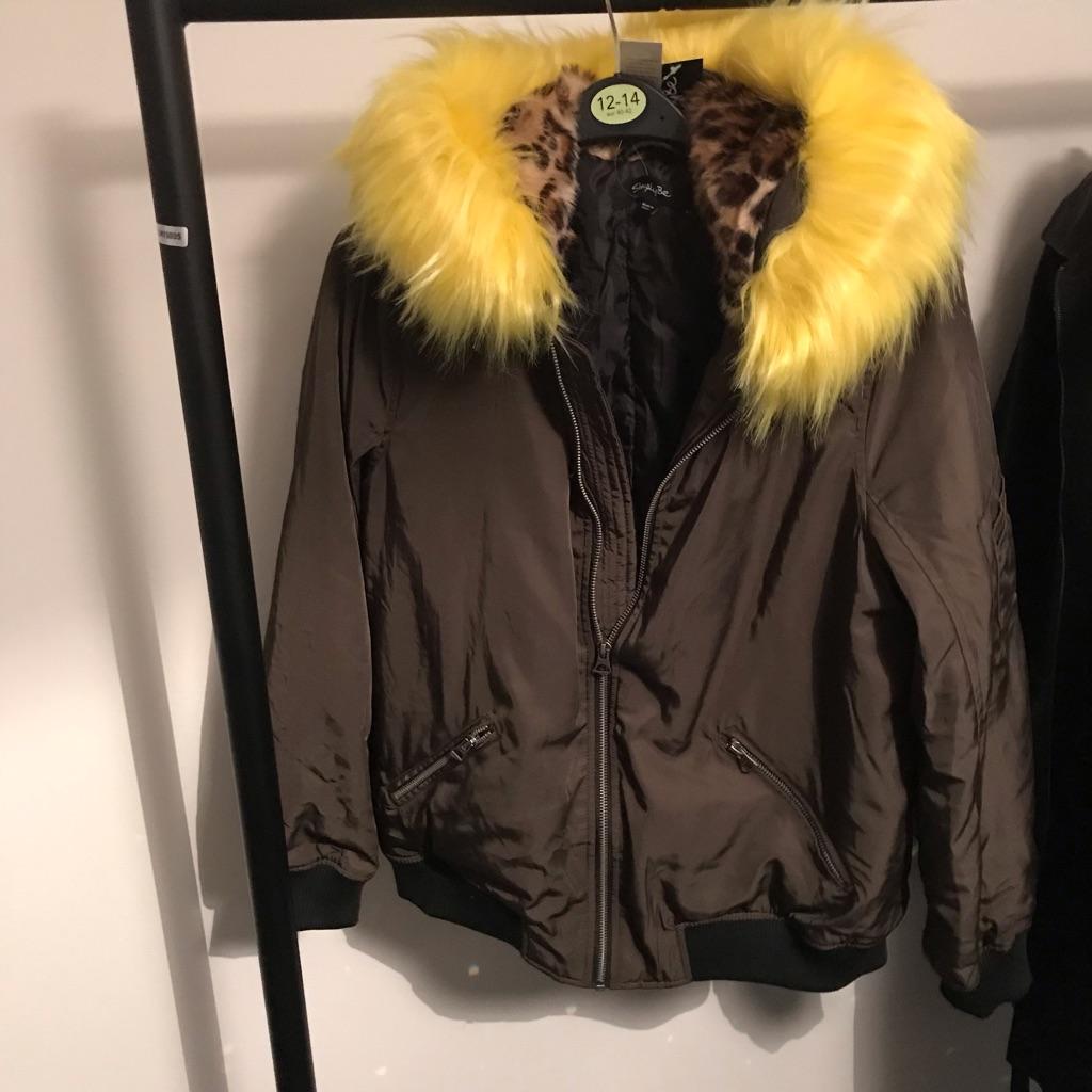 Khaki bomber jacket with faux fur hood