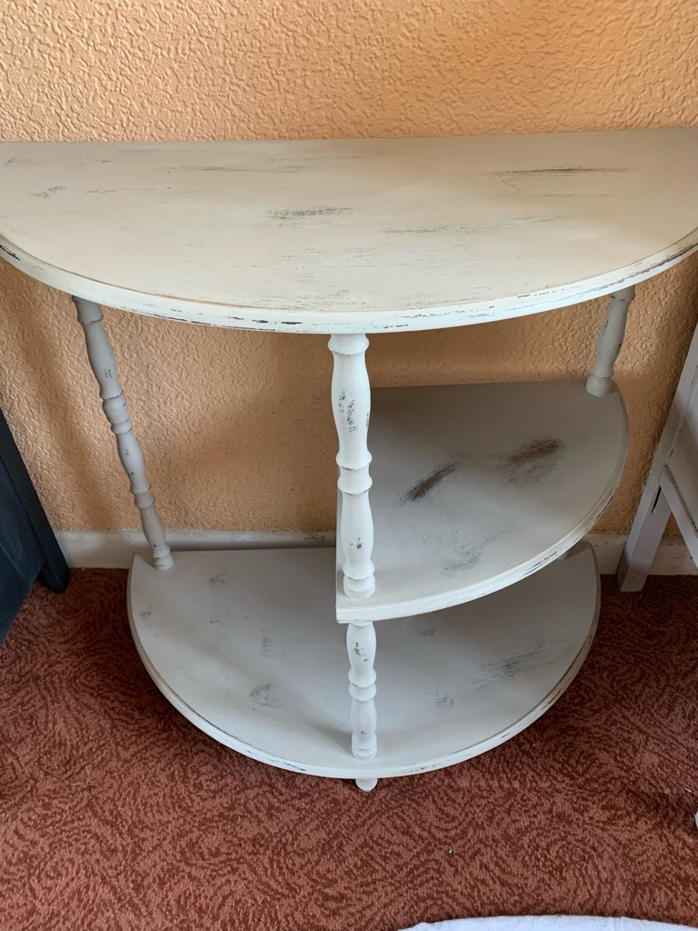 Upstyled three levelled table