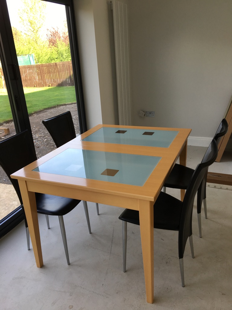 Table, four leather chairs and a cabinet