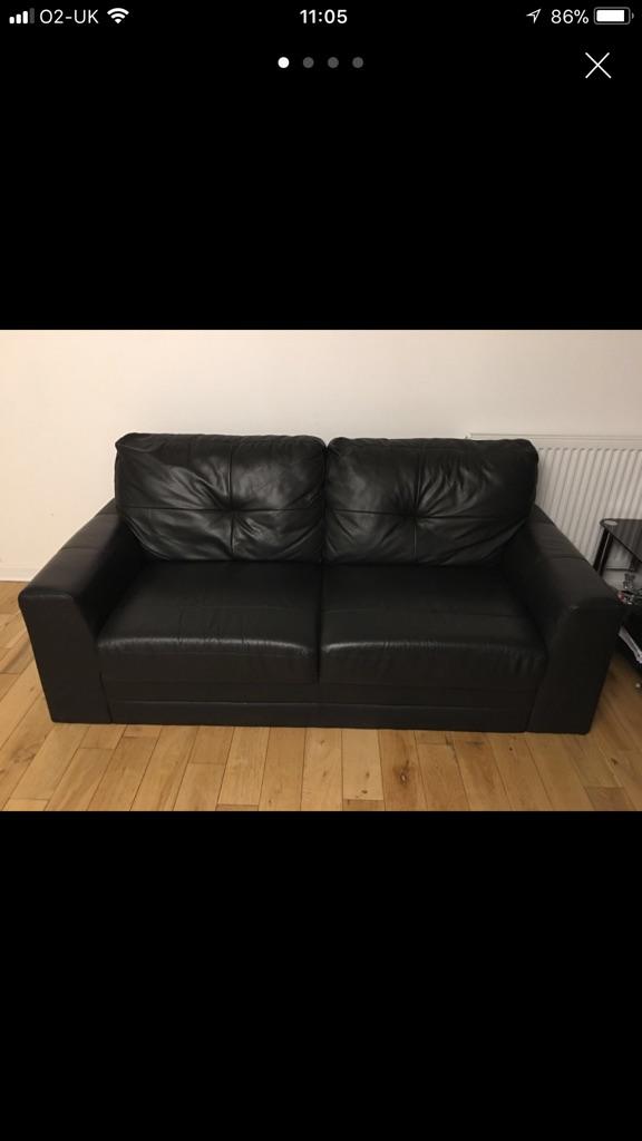 Two Black leather sofas