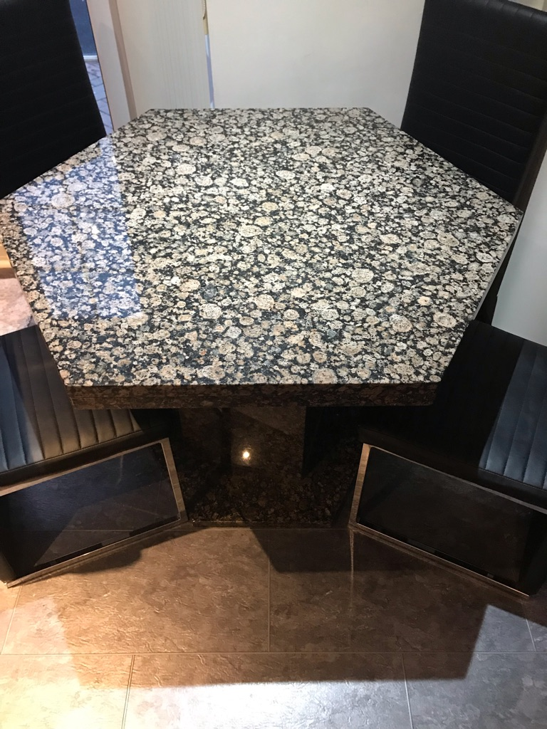 Granet table and leather chairs