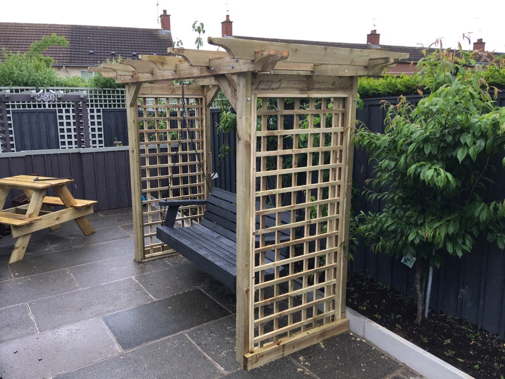 Garden arbour with swing seat