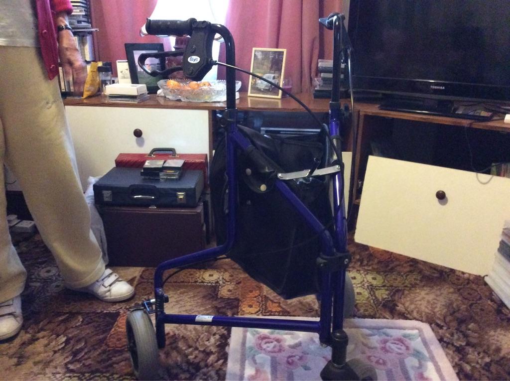 Trip wheel walker