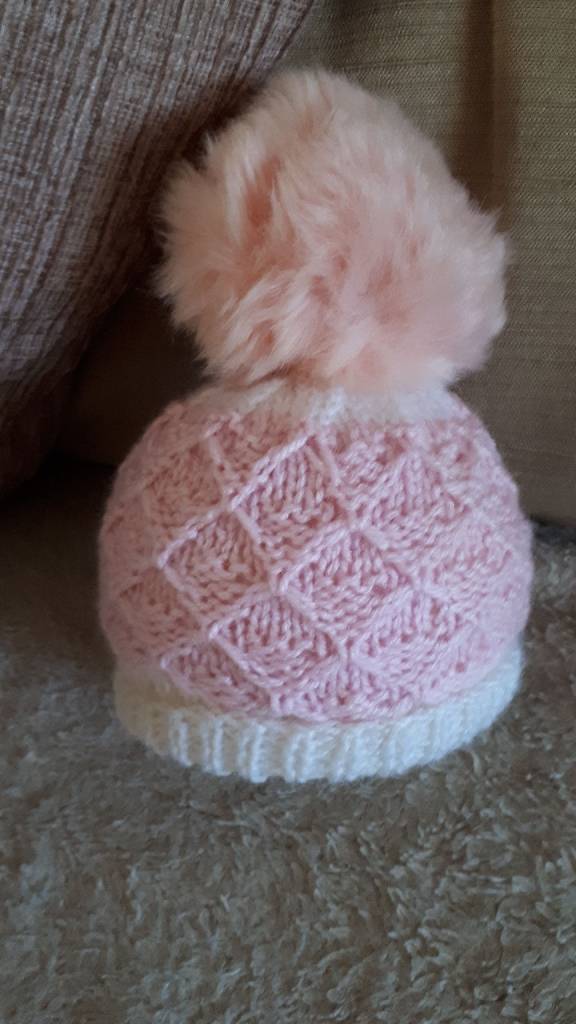 Baby girl's pompom hats and bonnets
