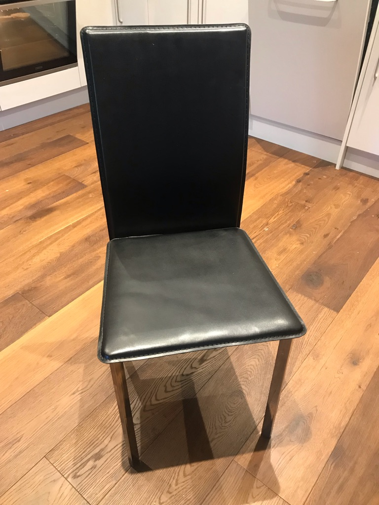 2x black leather chairs
