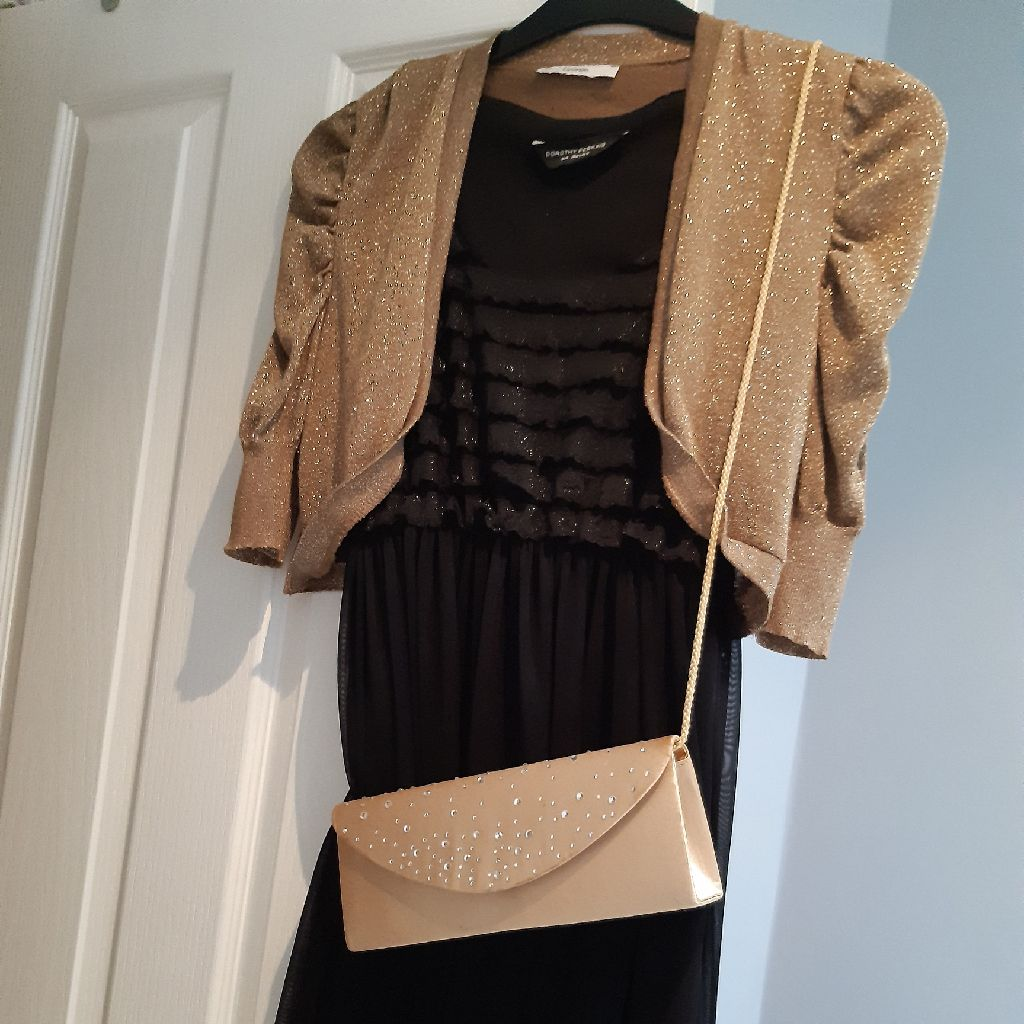 Black sleeveless dress. Gold fine knit bolero and shoulder bag