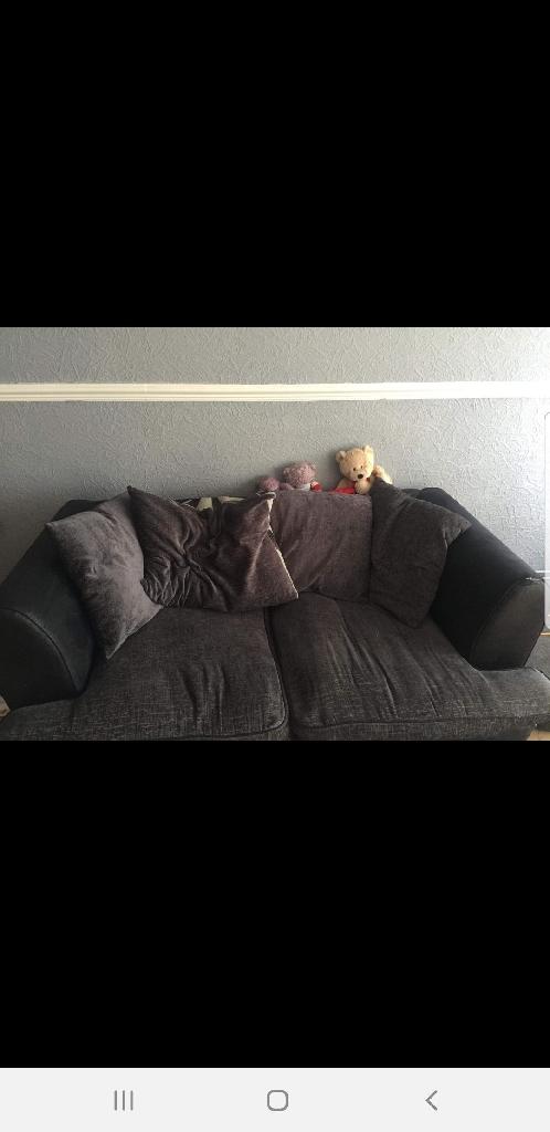A large 2 seater fabric sofa