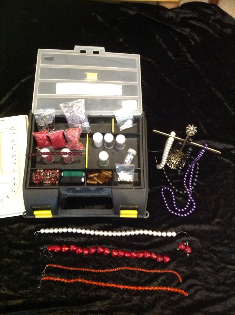 Box of seed beads, bead strings and jewellery making tools