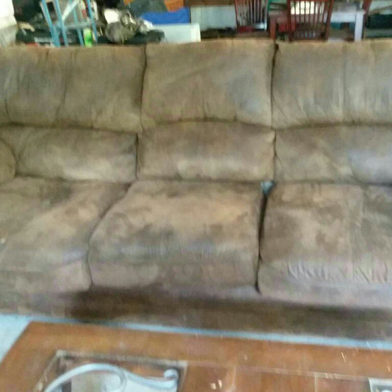 Couch and love seat with coffee table