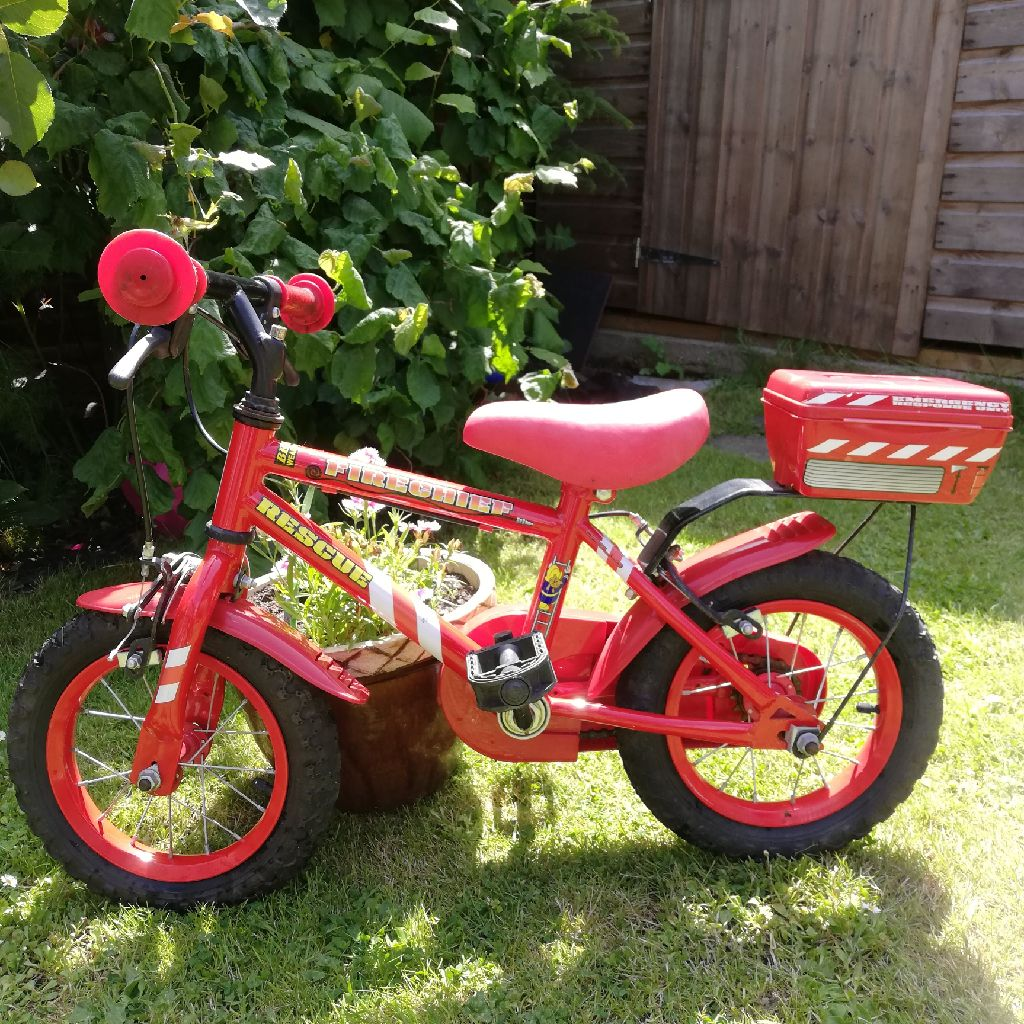 Child's red Fireman bicycle