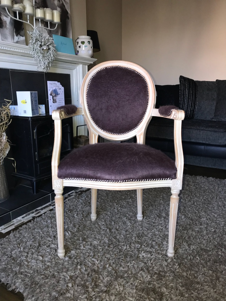 Victorian chair with textured purple fabric