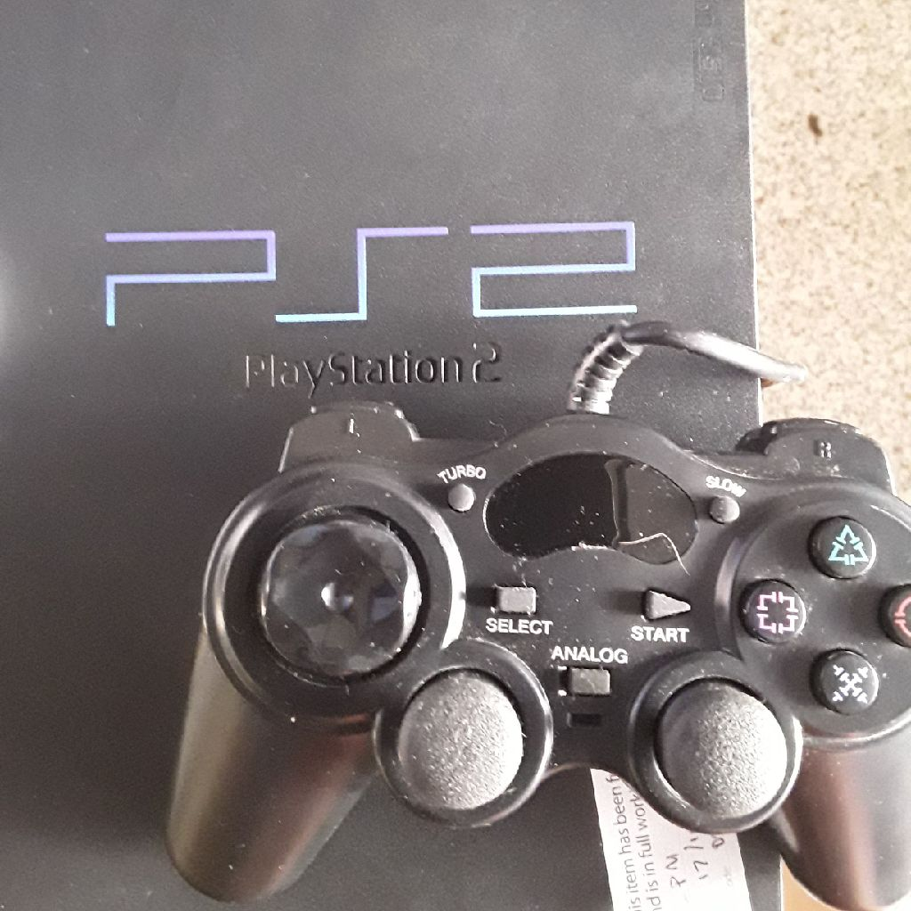 PS2 TWO CONTROLLERS AND FOUR GAMES