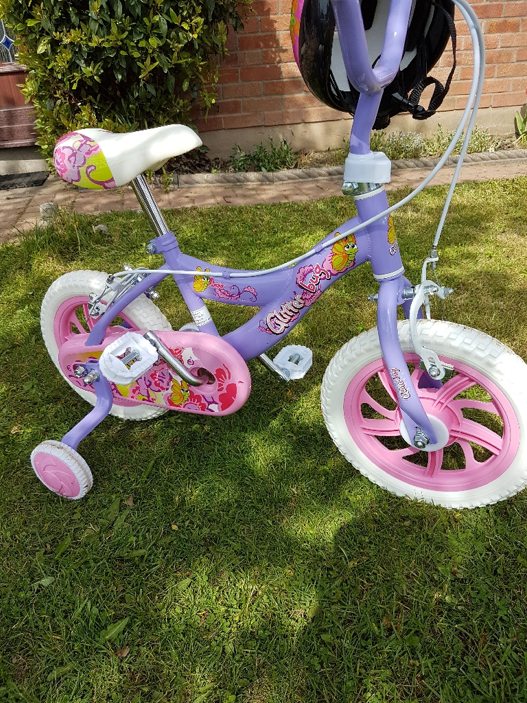Glitter Bug girls bike with stabilizers and helmet