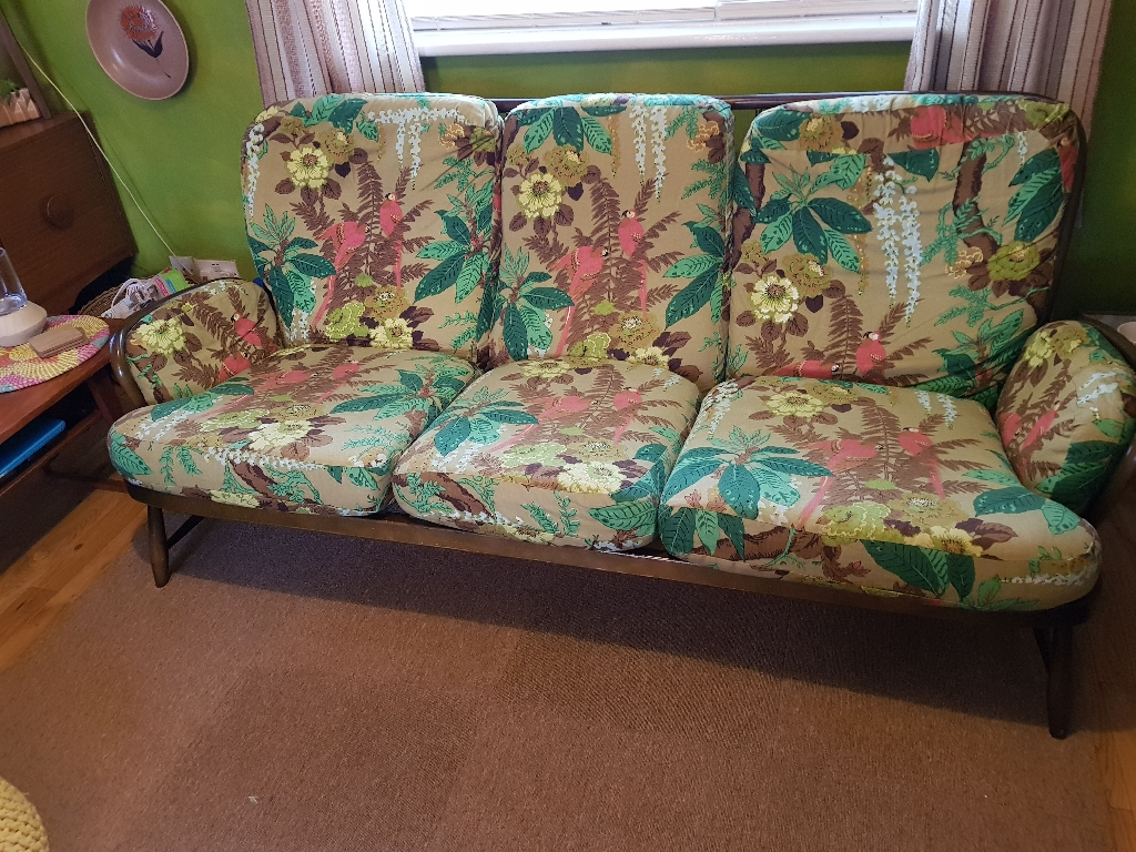 Ercol jubilee sofa and two chairs