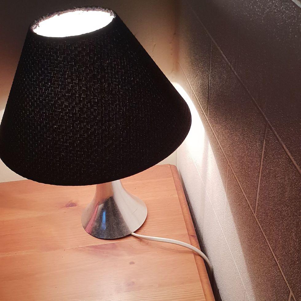 2 black bedside lamps