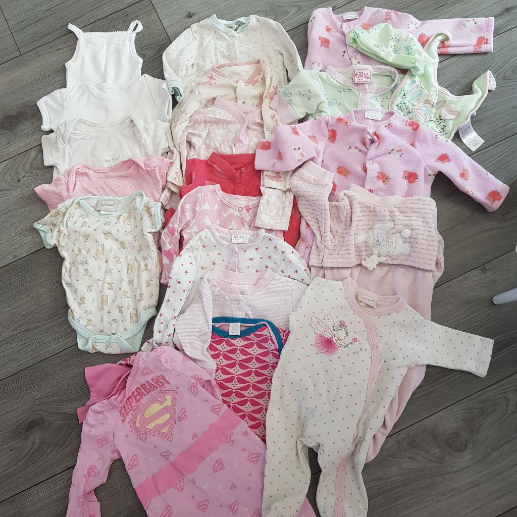 Bundle of baby girls clothes babygrows and vests