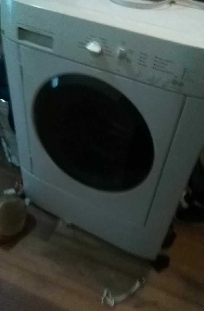 Washer and a dryer in a dresser
