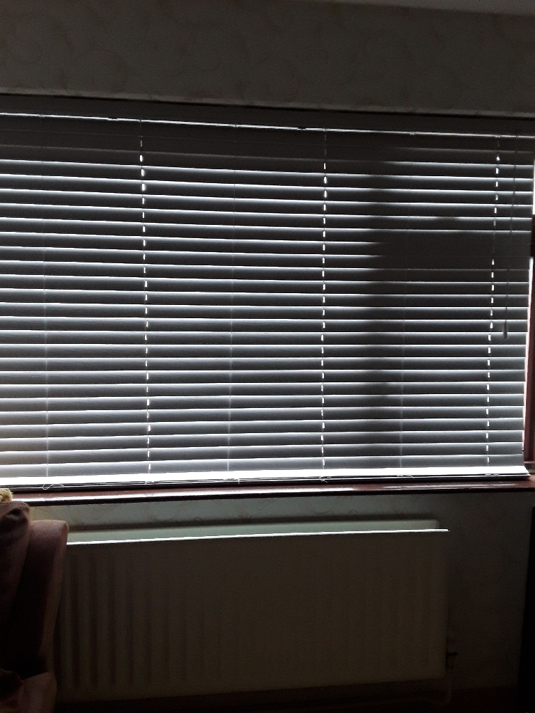 Grey slatted PVC blinds