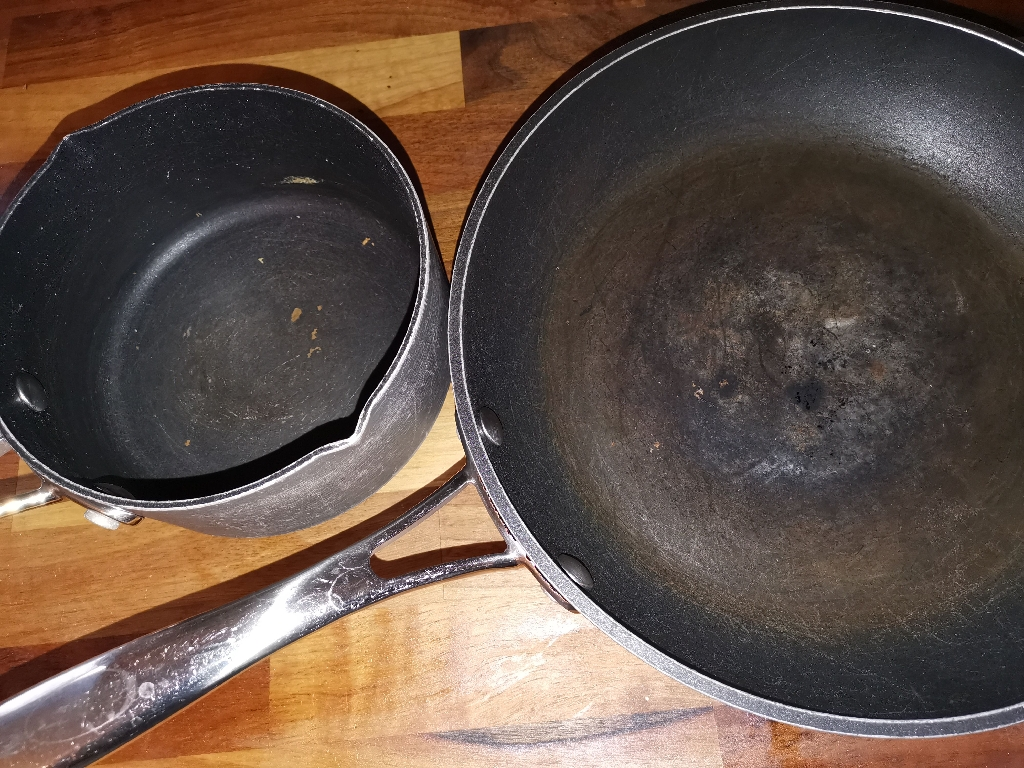 4 pots and pans. Used and marked