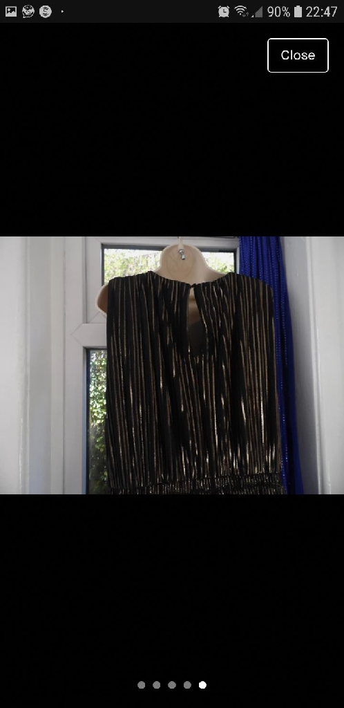 Lovely black and gold dress from FIND clothing