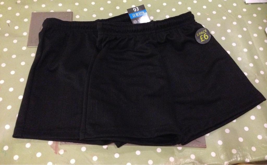 Black PE shorts age 5