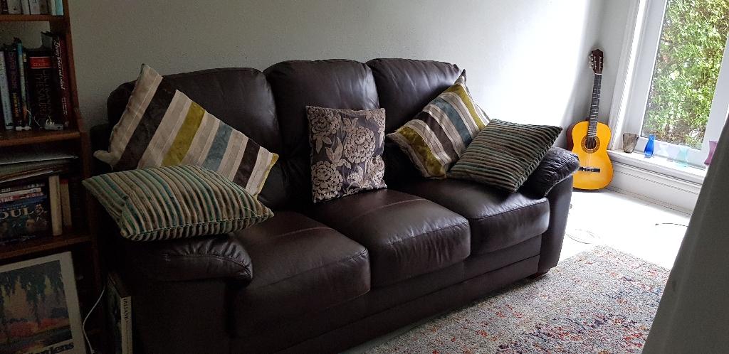 3 seater Dark Brown leather sofa by Harveys