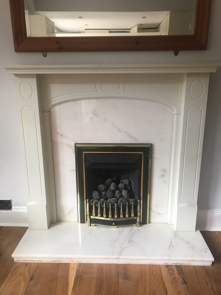 Fireplace surround, marble backing and marble mantel