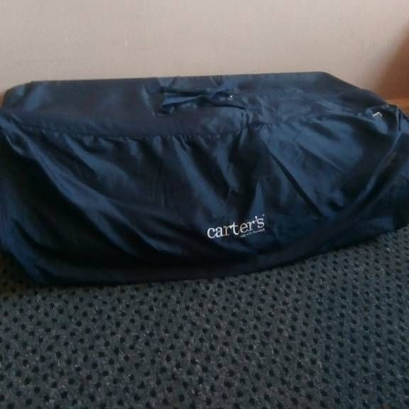 Brand new blue baby travel cot never been used