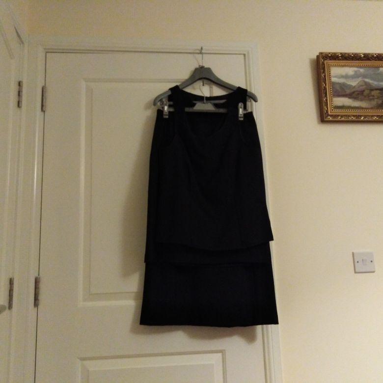 Skirt top and maching sleeveless a line dress.