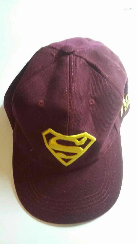 Cap & Hat with yellow superman logo on it