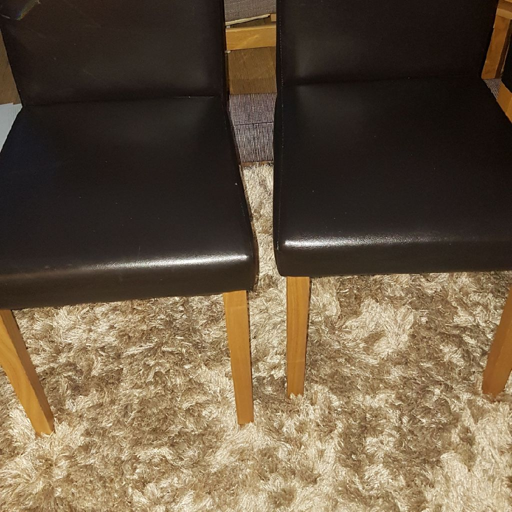 6 faux leather brown chairs