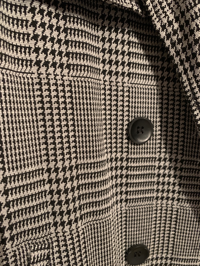 Longline dogtooth print trench coat.