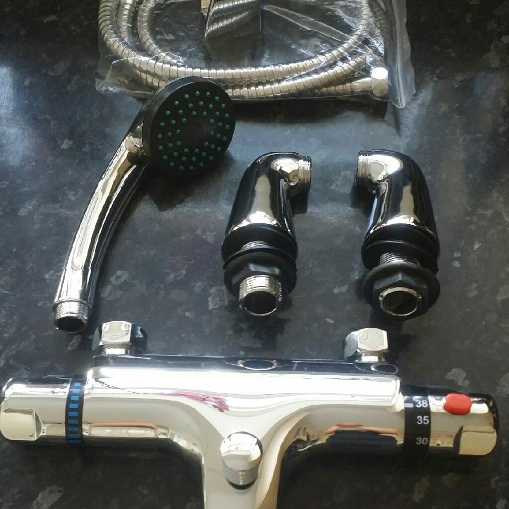 Brand new thermosthatic mixer tap with hand held