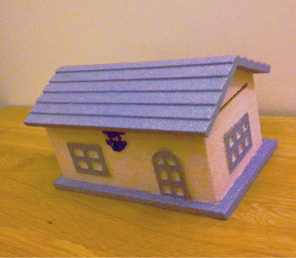 Wooden doll house piggy bank