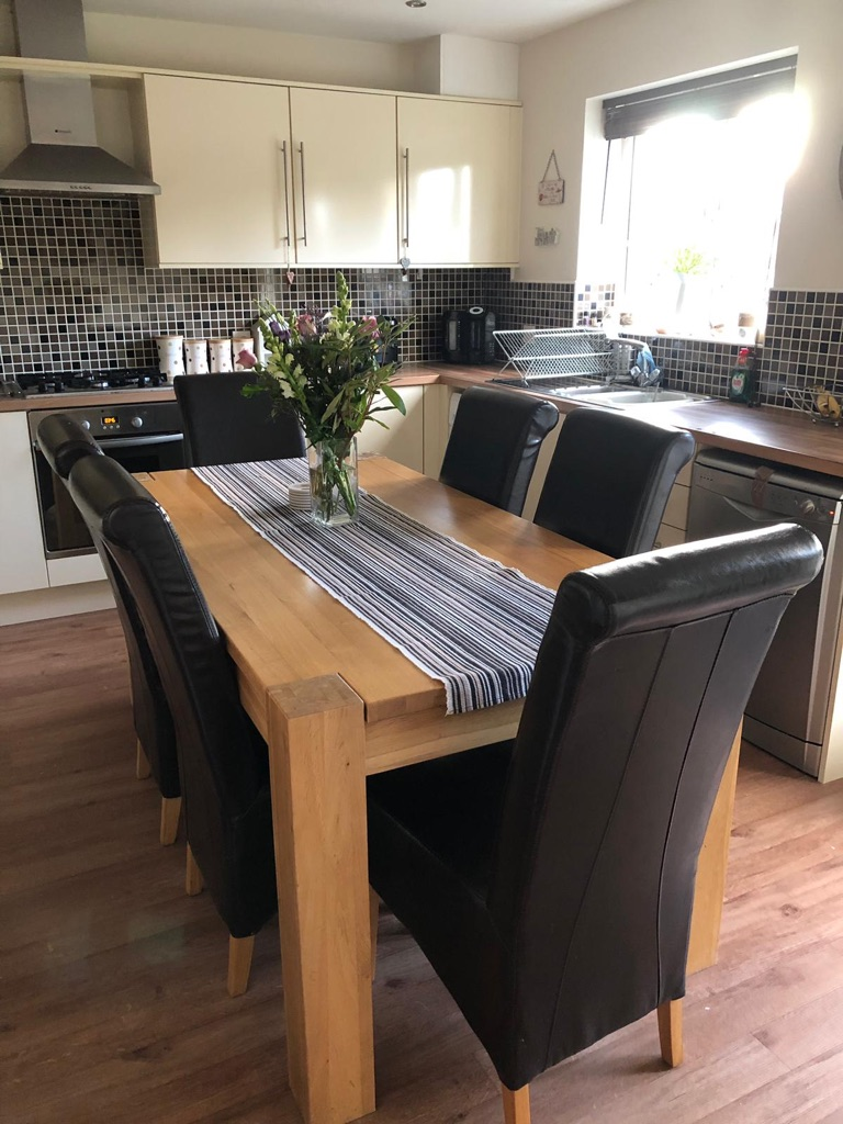 Solid oak wooden dining table and 6 chairs