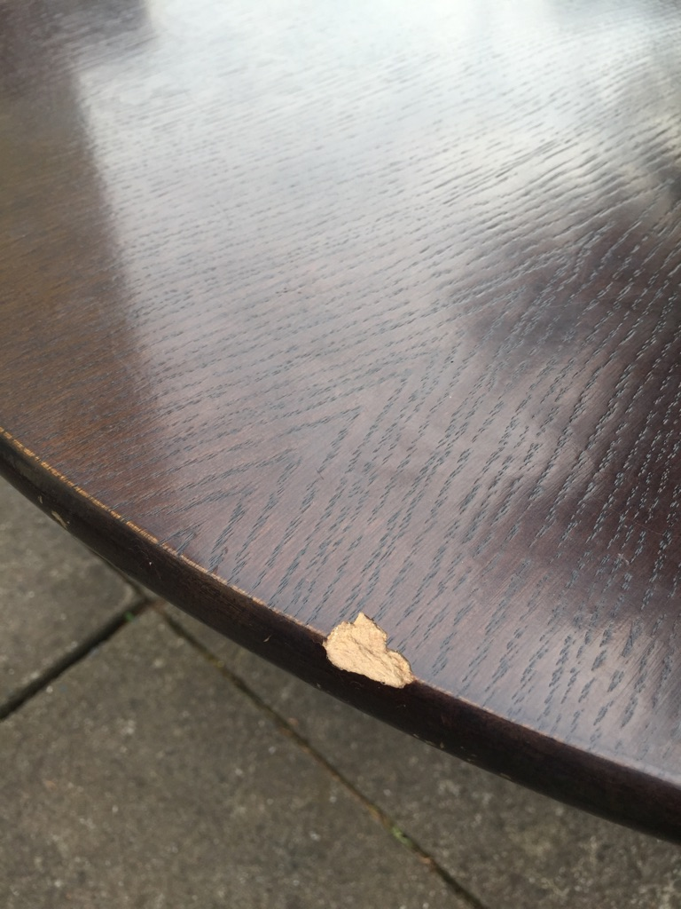 Oak table with chip mark fixer