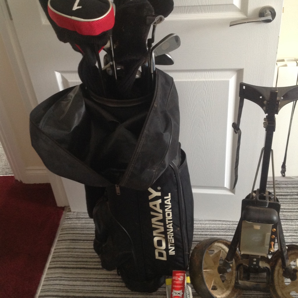 Full set of golf clubs with trolley.