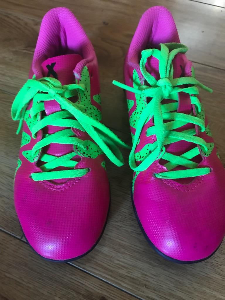 Pink girls football boots