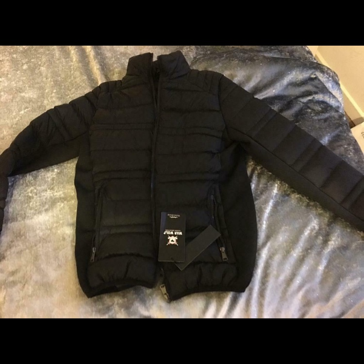 Brand new coat with tag unisex