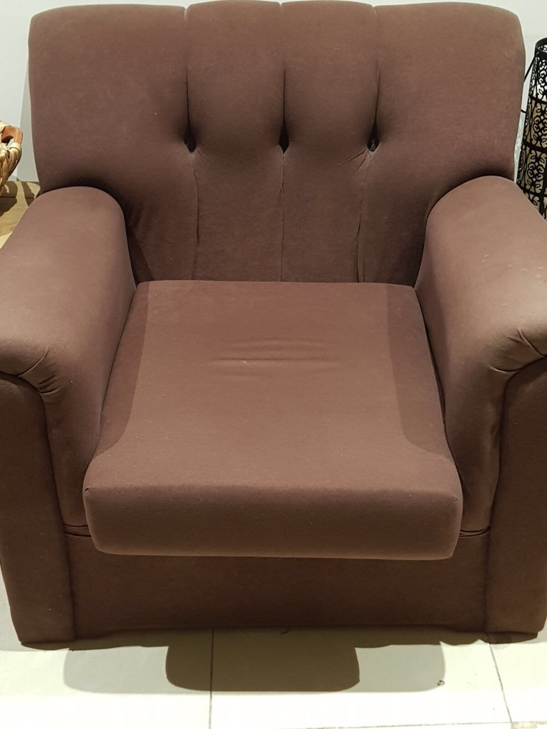 2 Brown soft material armchairs