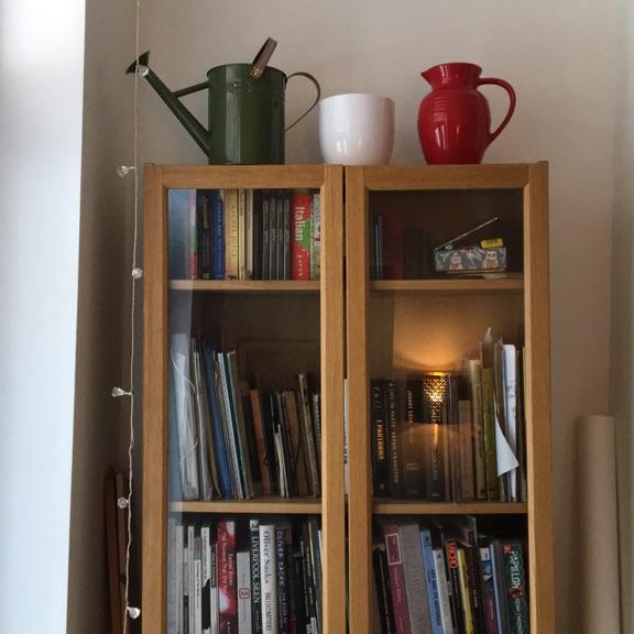 Solid wooden bookshelf with glass doors